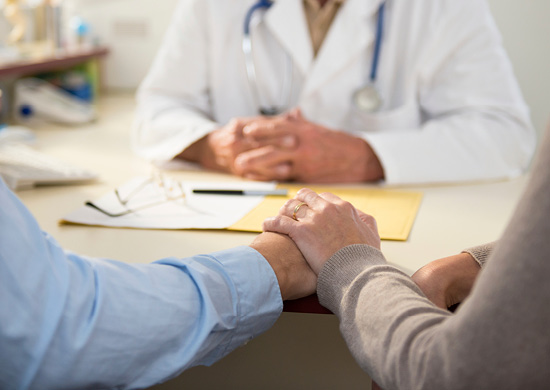 Image of doctor talking to patient